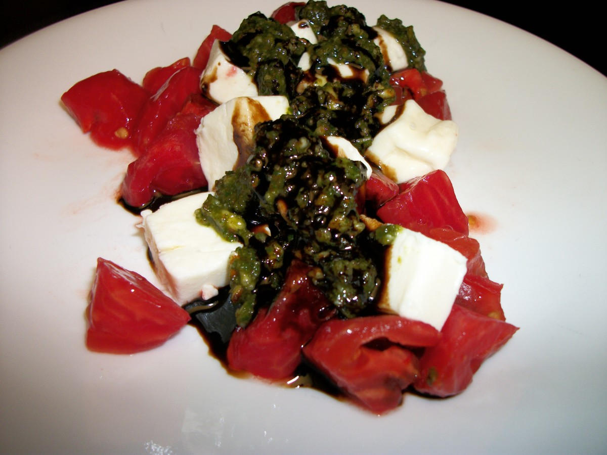 Traditional Caprese Salad is made by alternating slices of tomato and mozzarella. I have cut mine in cubes.