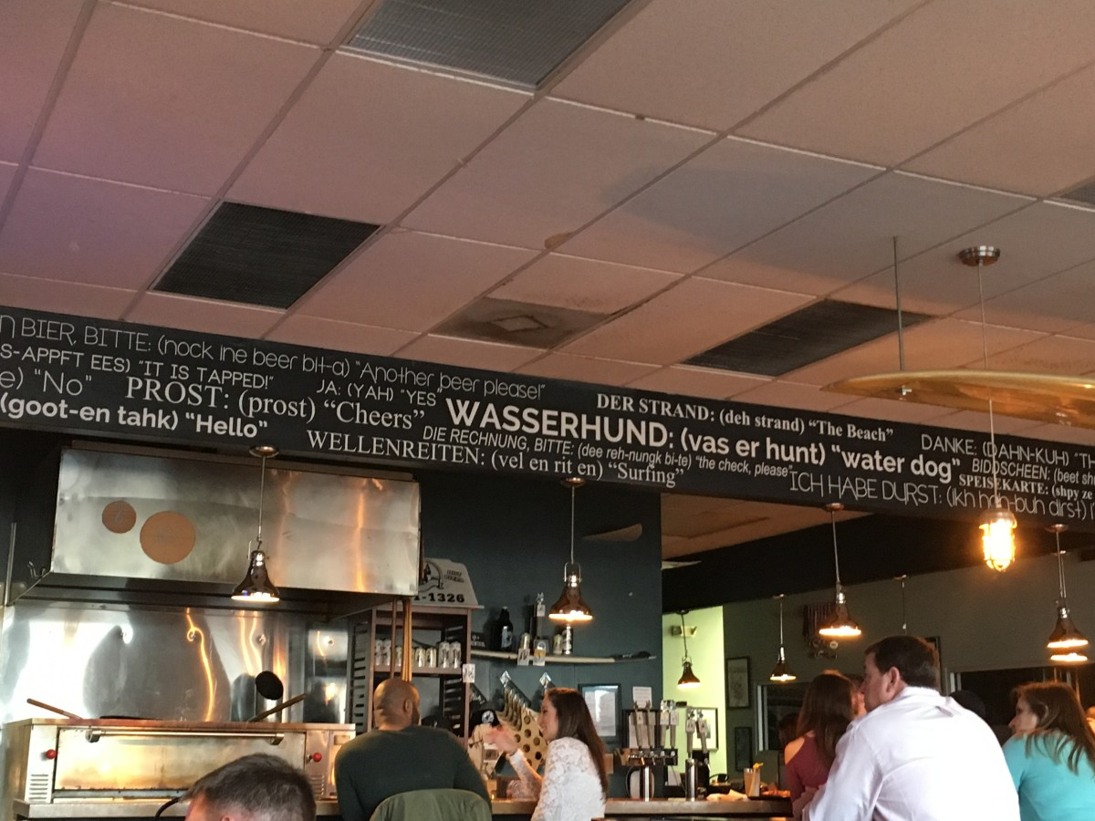 Above the bar are a bunch of different German phrases and their English translation.