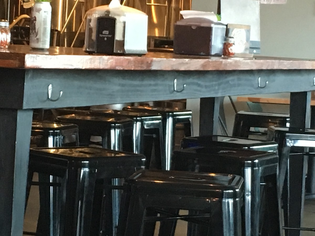 Ladies don't have to worry about putting their purse on the floor, or taking up precious table space. Each of the high tables is covered in purse hooks!