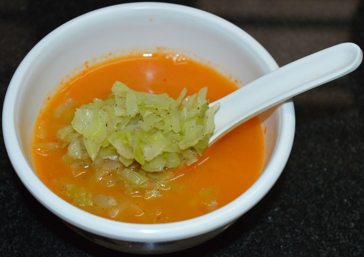 Step eight: Keep ready four soup bowls. Add tomato puree equally to the bowls. Add sauteed cabbage equally to each bowl. Enjoy drinking this delightful and refreshing soup!