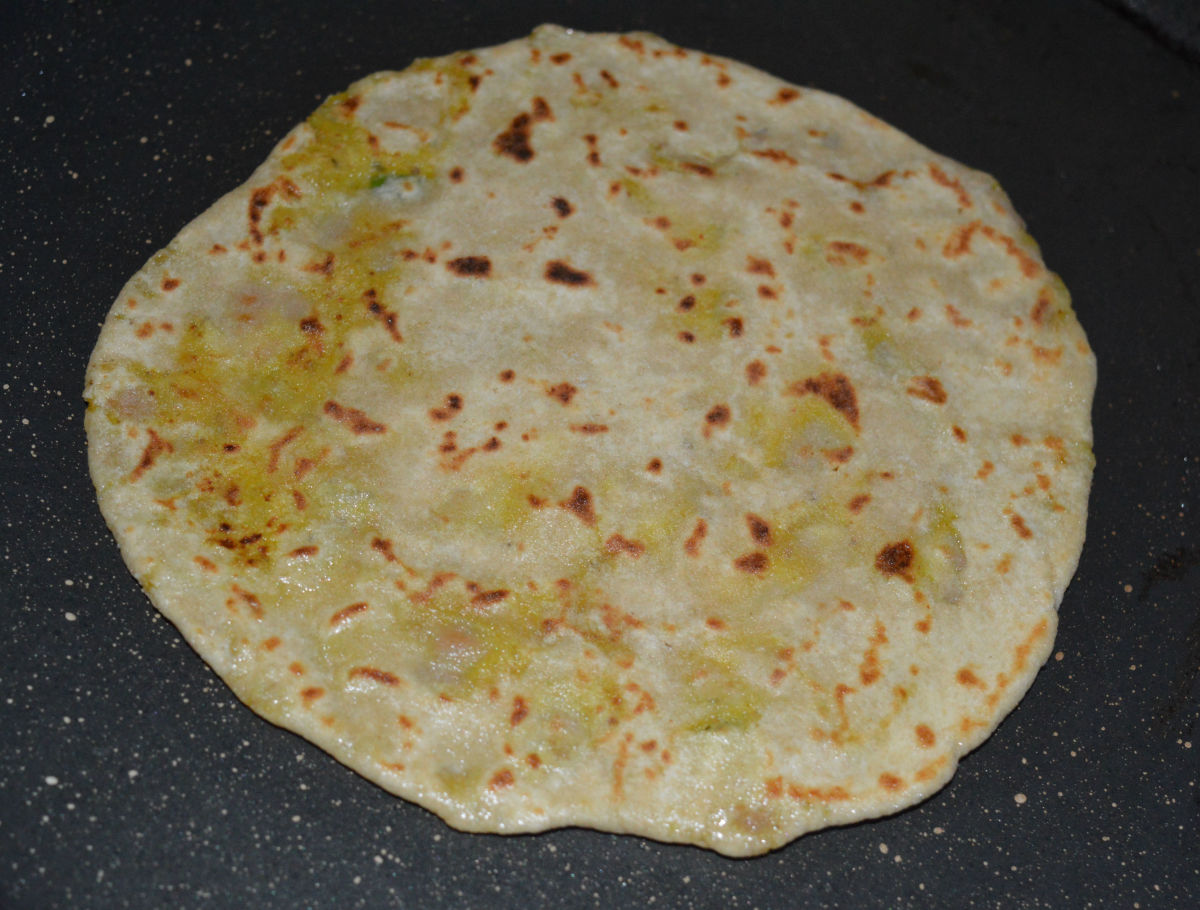 Step seven: Remove it and place on a serving plate. Repeat the same procedure to make all the parathas.