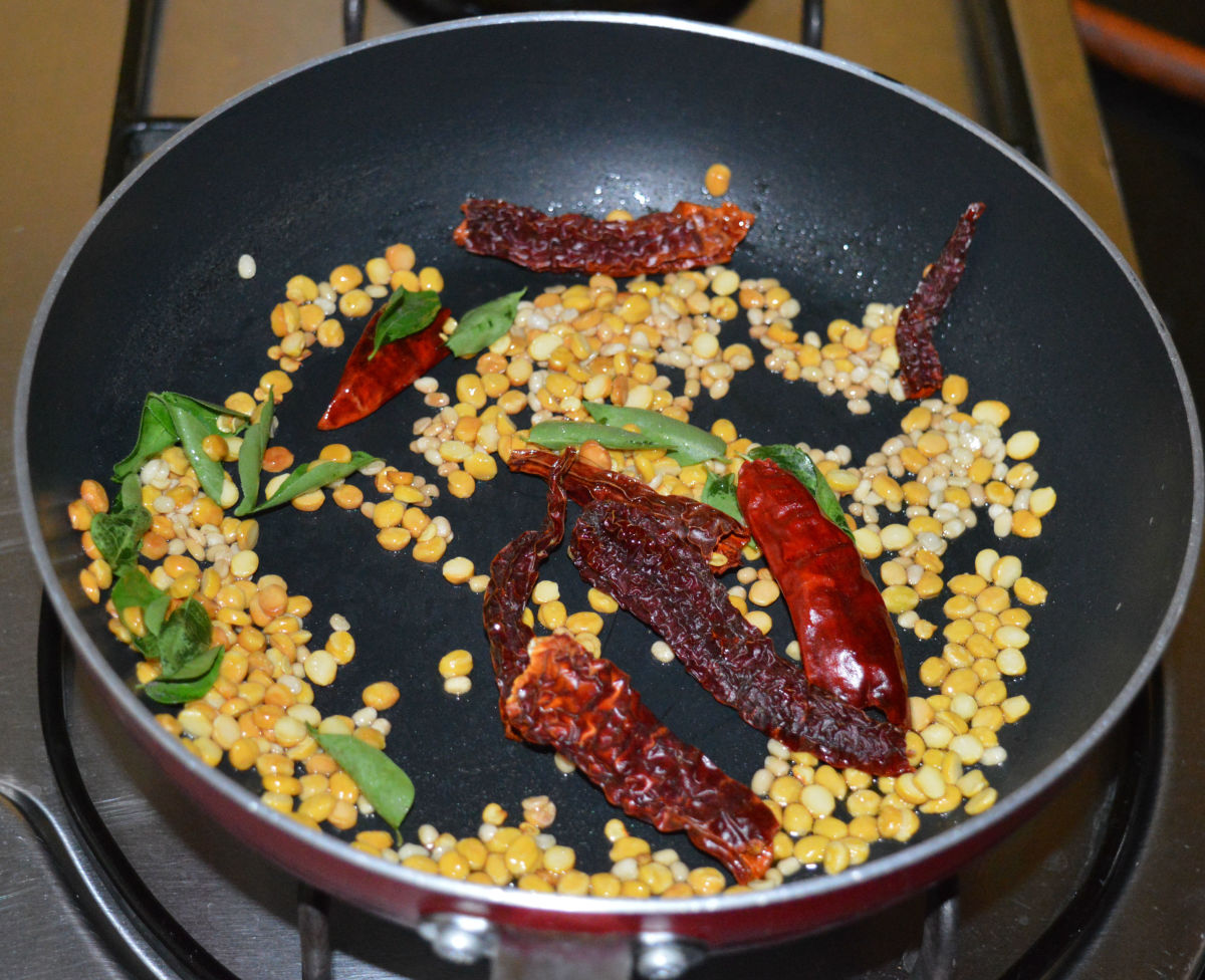 Step one: Saute lentils, curry leaves, and broken dry red chilies in oil as per instructions