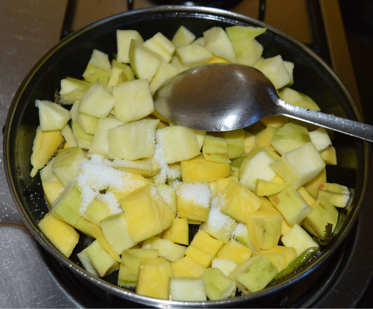Step four: Add chopped mangoes. Throw in some salt. Mix well. Saute for 3 minutes.