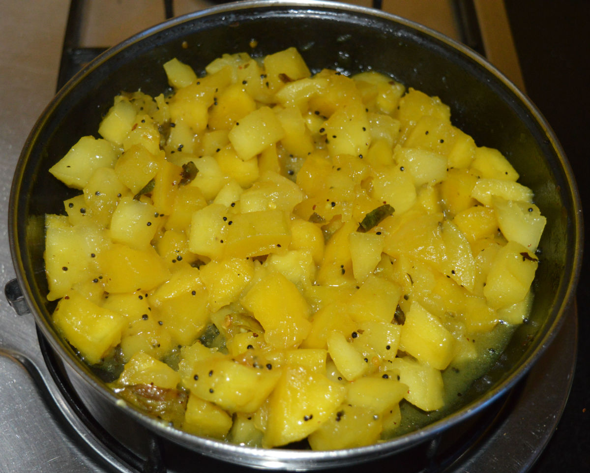 Cover the pan. Cook over low heat until mangoes are soft and cooked.