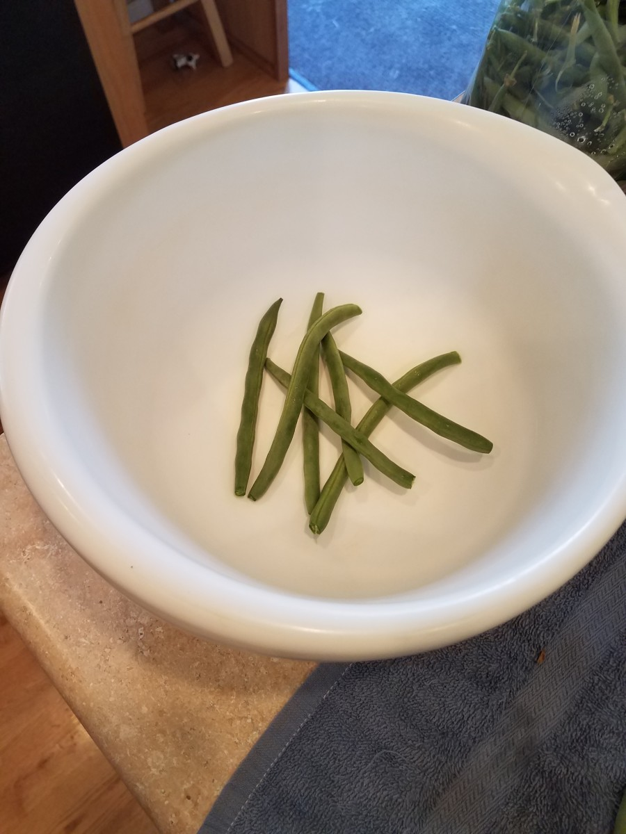 Drop them in your bowl and do this with all of your green beans.