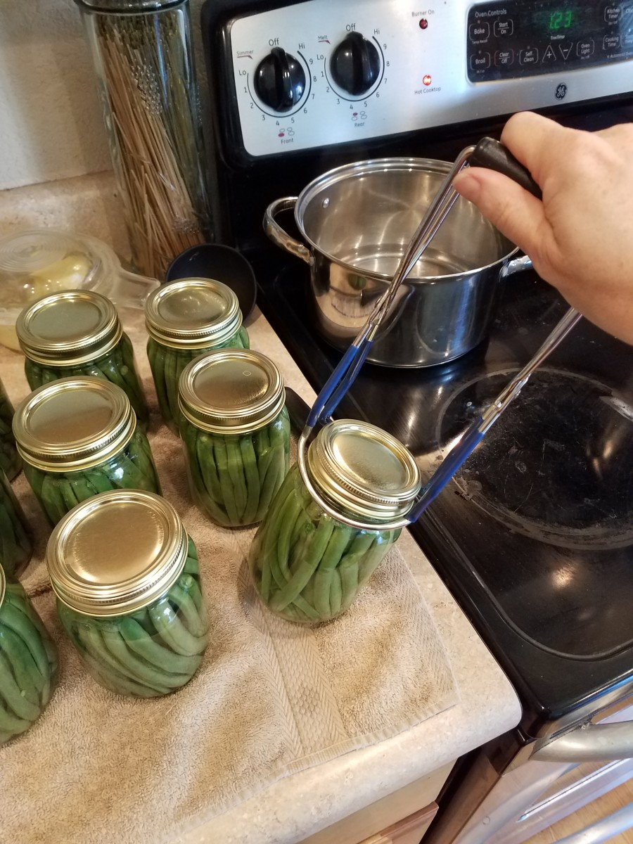 With your jar lifter, move finished jars to your canner. Fill the canner with only 3 quarts of water.