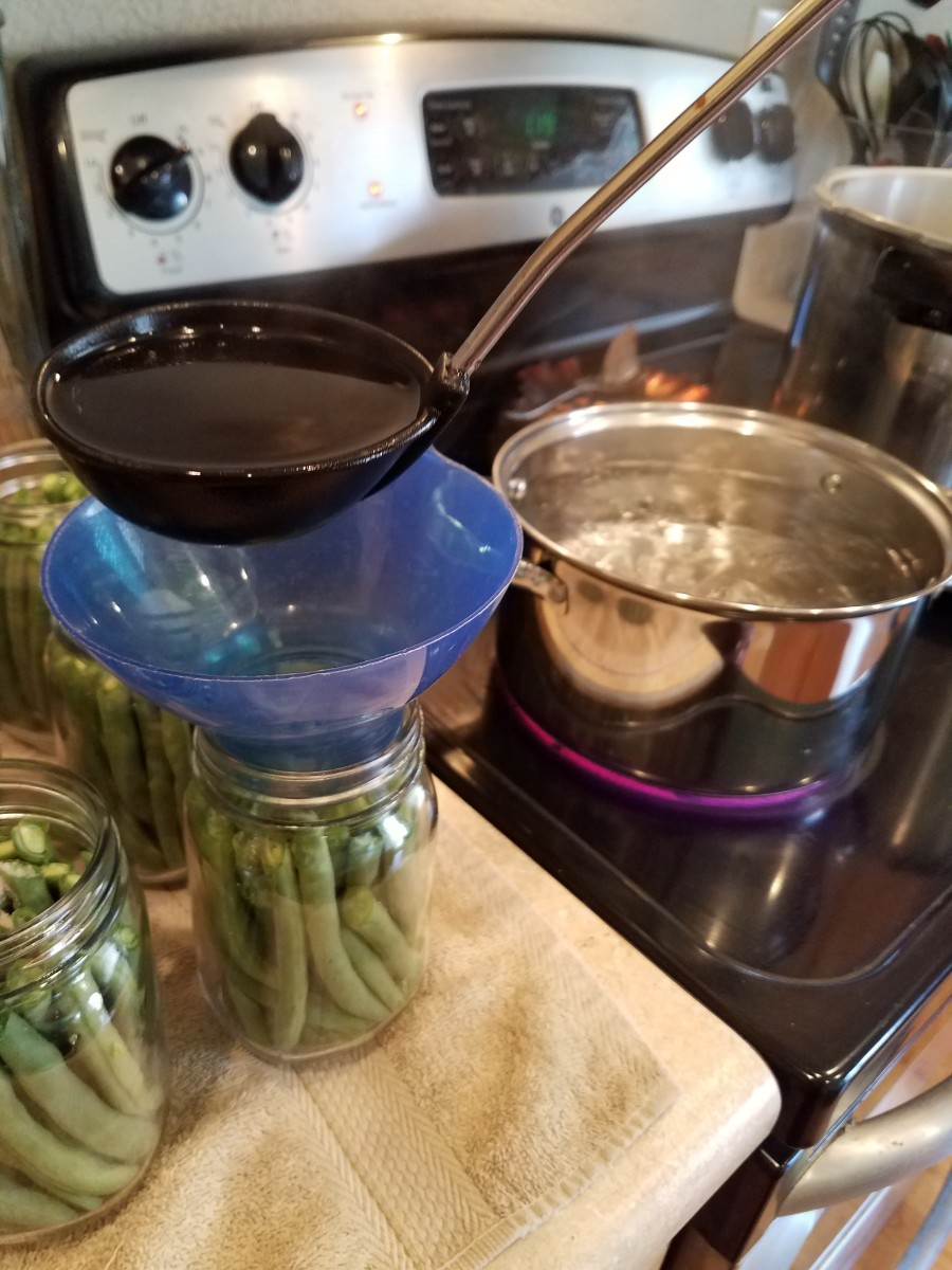 And then fill each with boiling water, only up to the neck of the jars.