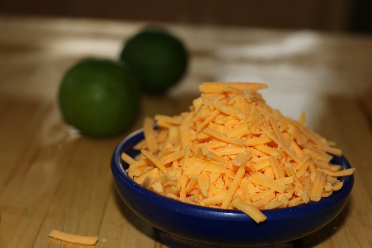 bowl of shredded cheddar cheese