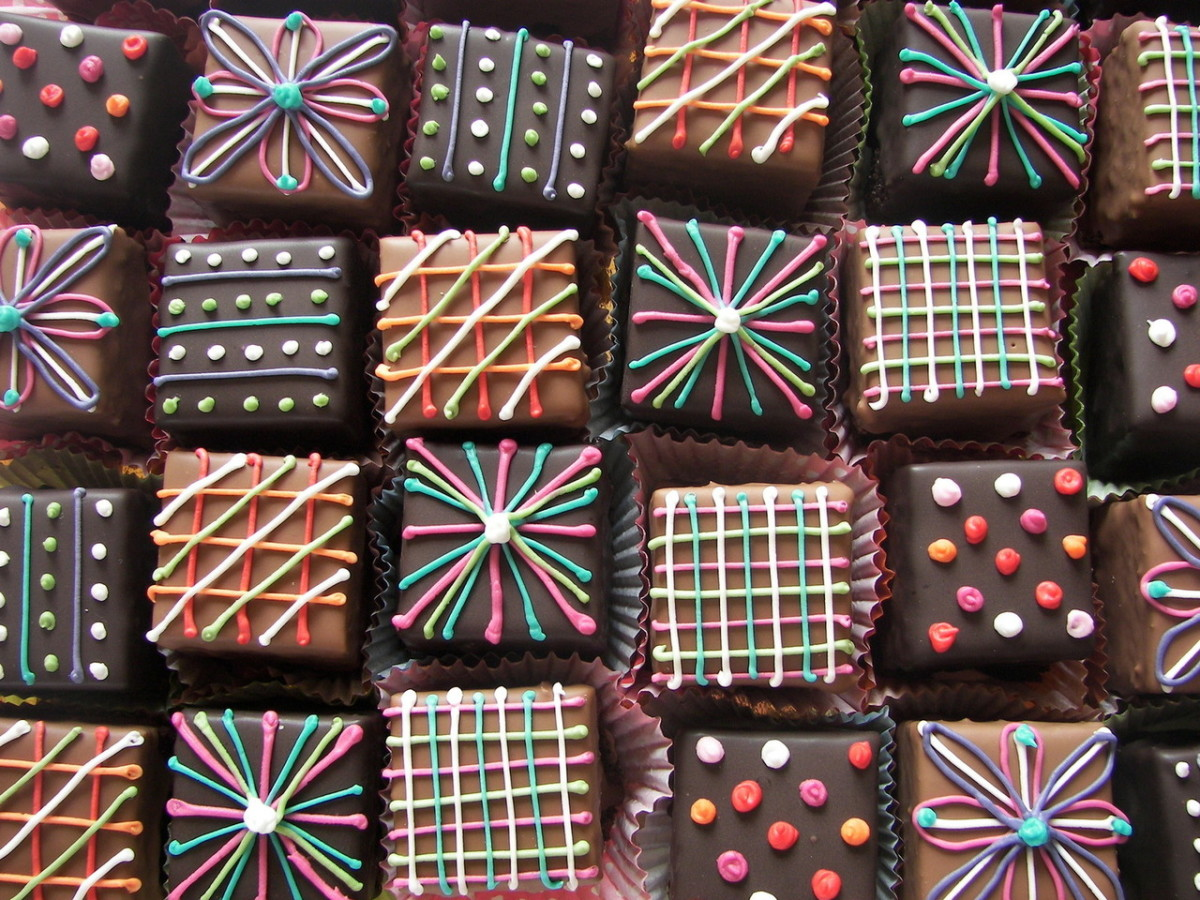 Basic lines and dots of icing or melted chocolate make easy petit fours decorations.