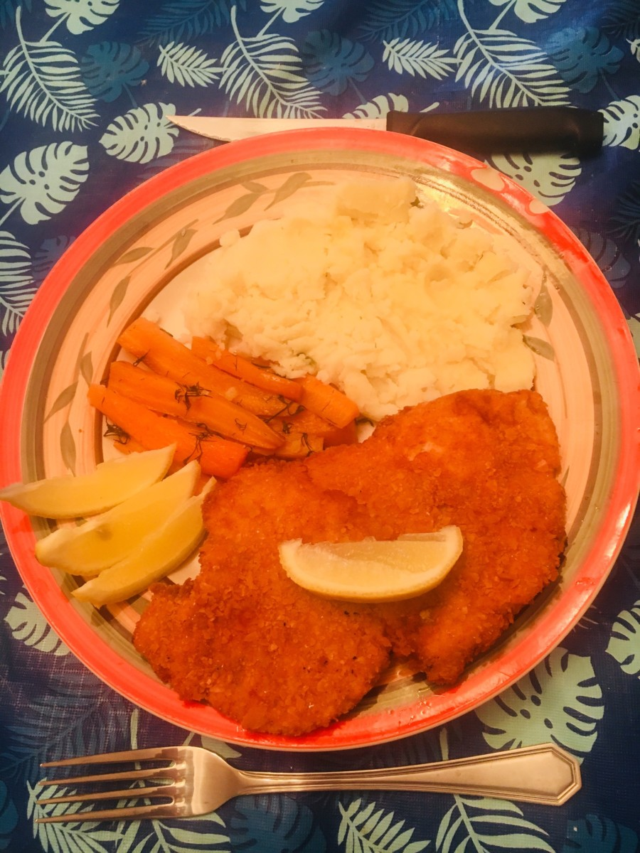 Schnitzel served with Mash Potatoes and Carrots with Dill.