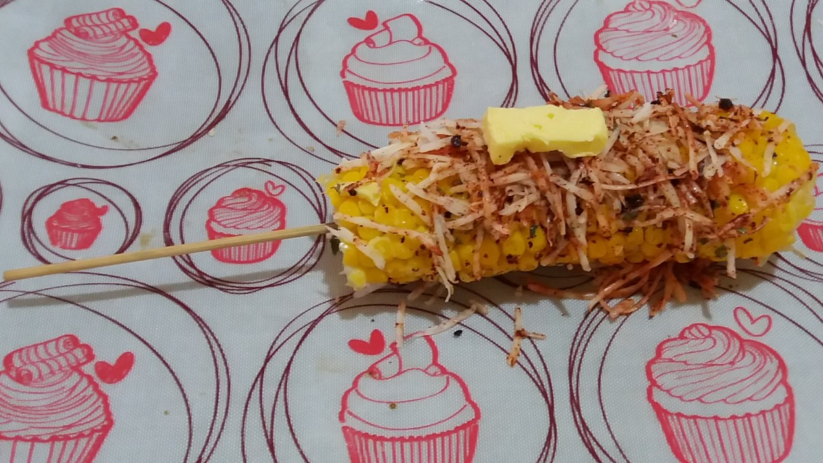 The completed cheese-spicy elote. You can top it with more cheese and butter.