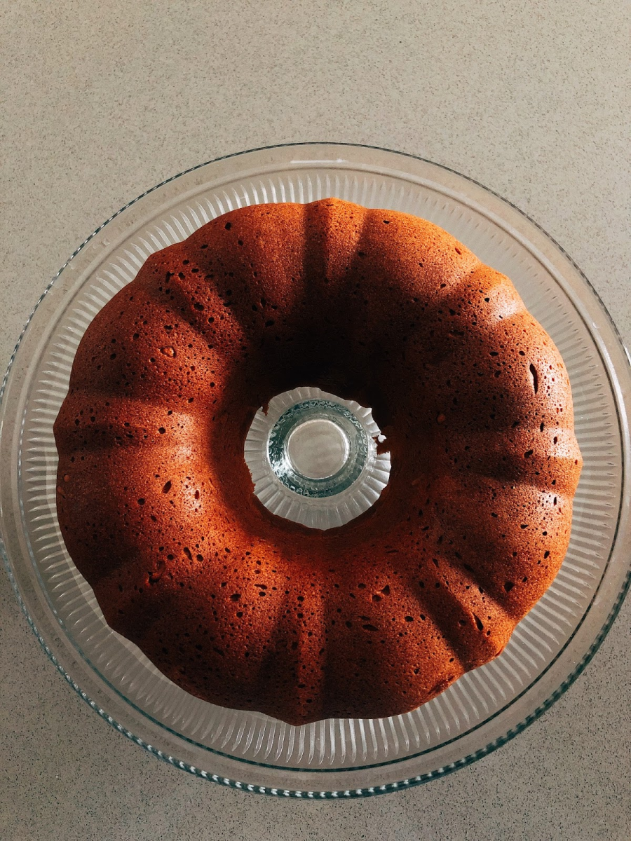 After the bundt cake is removed from the pan, place it on a cake stand.
