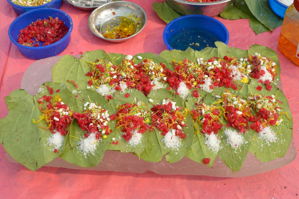 betel leaves with the paan ingredients.each betel leaf will be folded to make a paan