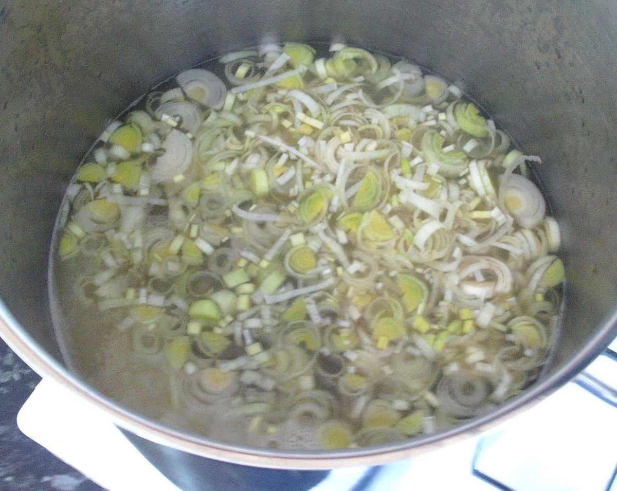 Leek is added to blended potatoes and stock