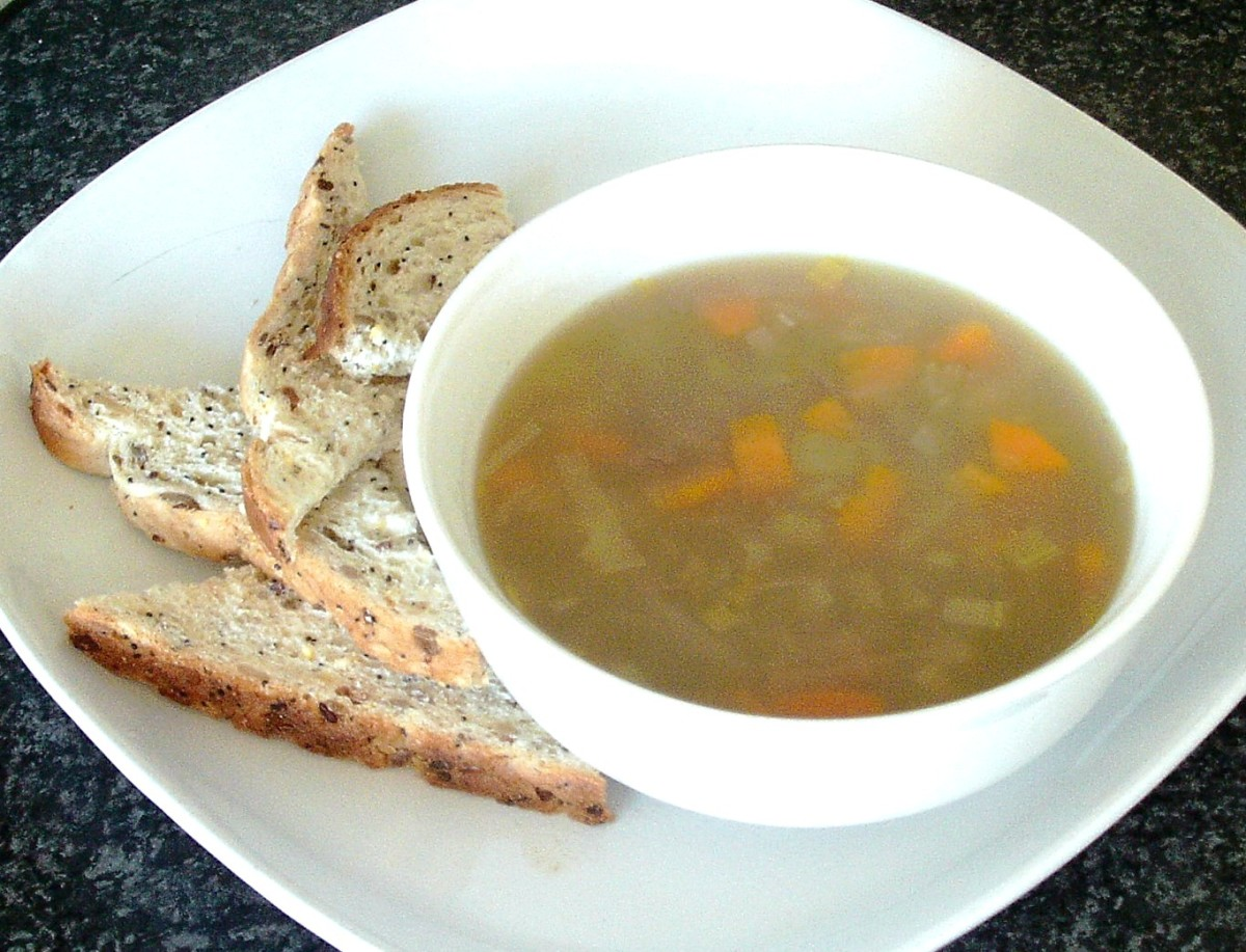 Hare and vegetable soup served with bread