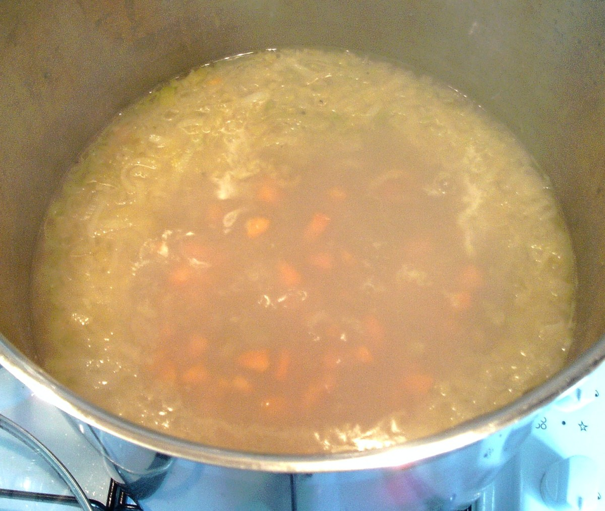 Hare stock and vegetables are brought to a simmer