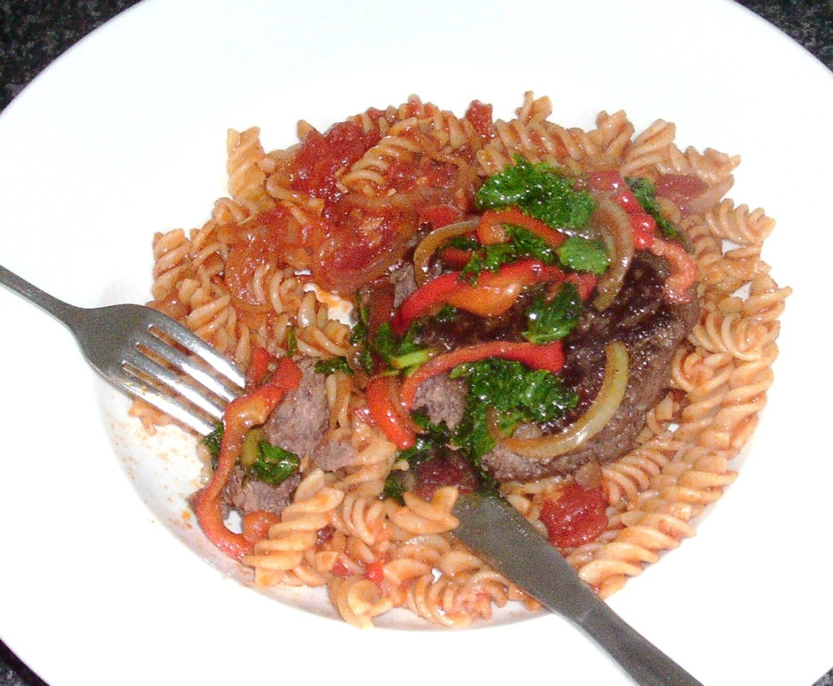 Enjoying ostrich burger and sauteed kale on spicy pasta