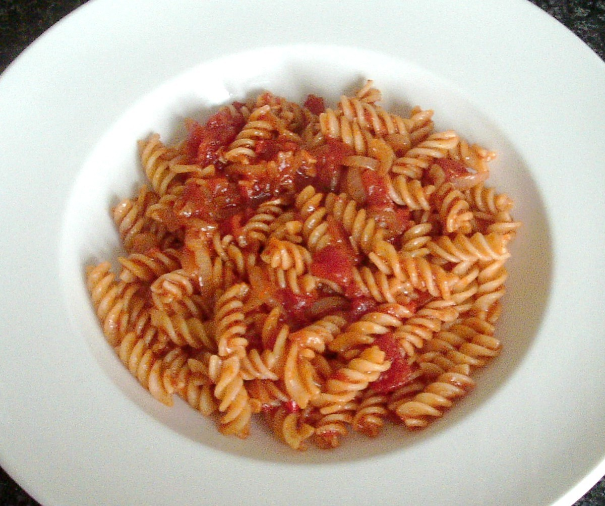 Plated pasta in spicy tomato sauce