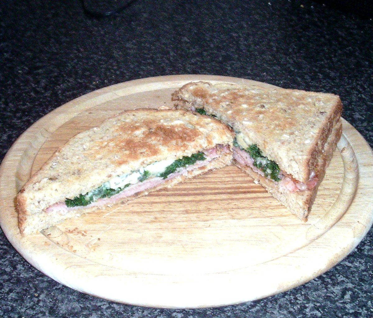 Kale, Stilton and bacon sandwich is sliced for service