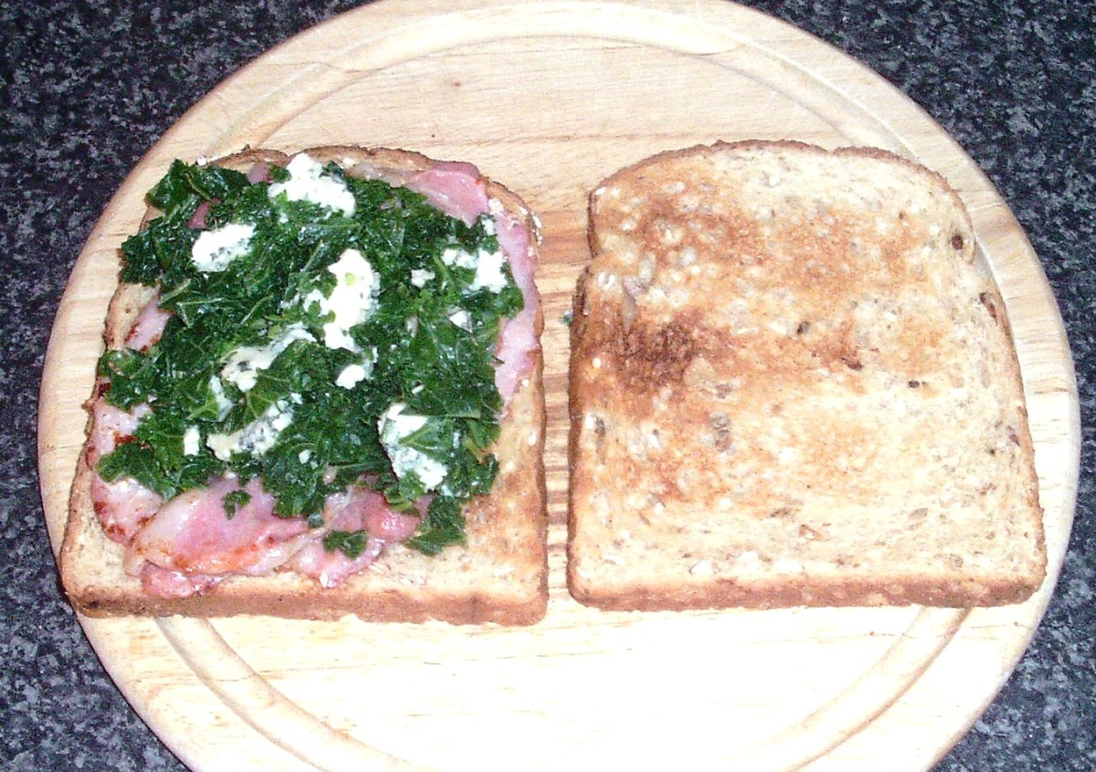 Kale and Stilton are arranged on hot bacon