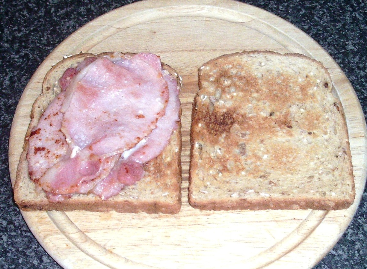 Bacon slices are laid on toast