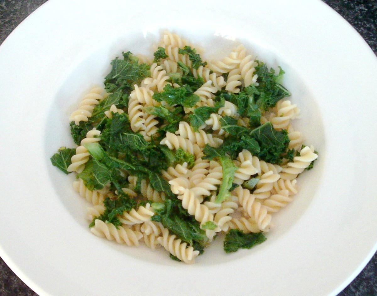 Kale and pasta bed is arranged for kippers