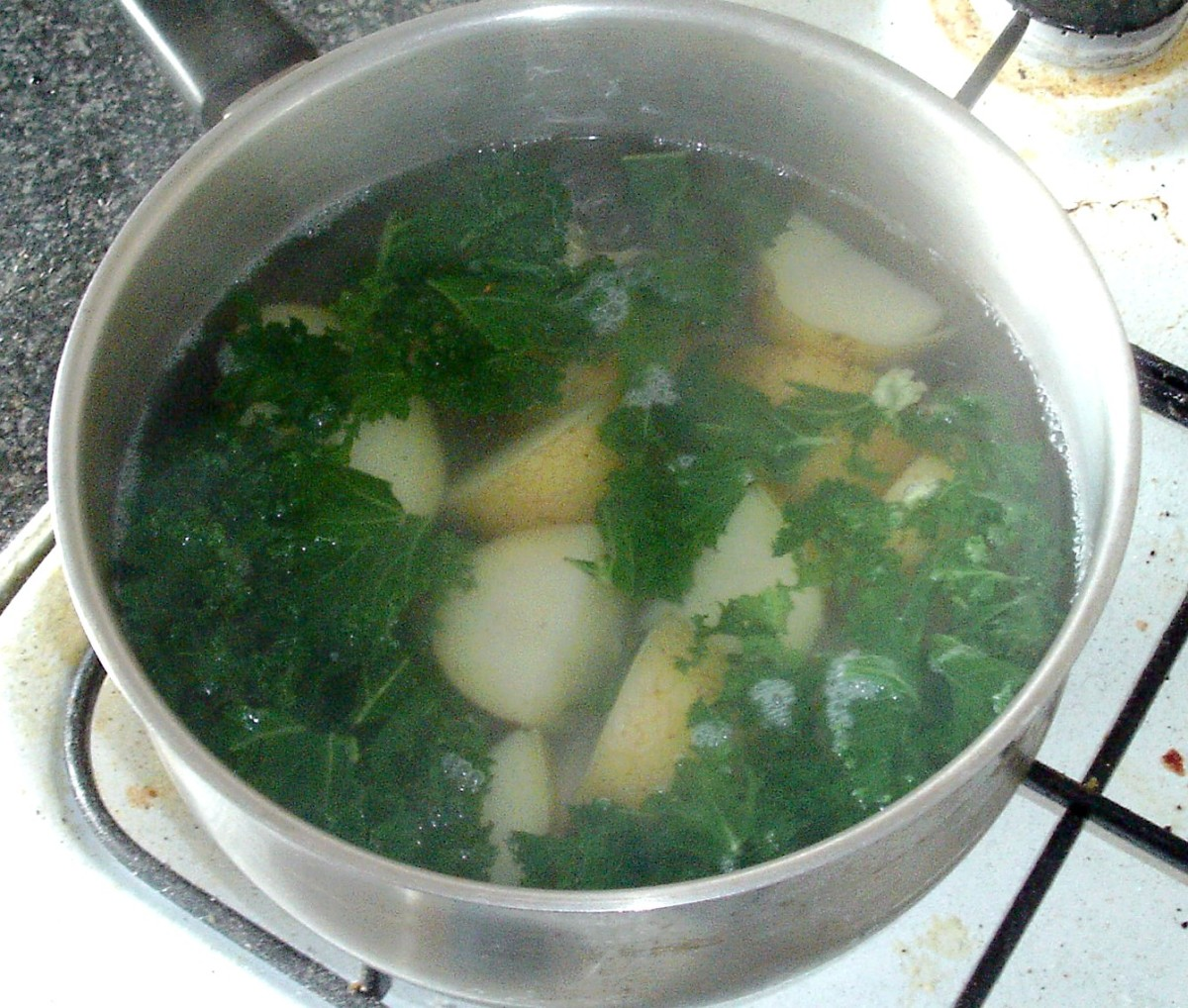 Potatoes and kale are simmered in boiling salted water