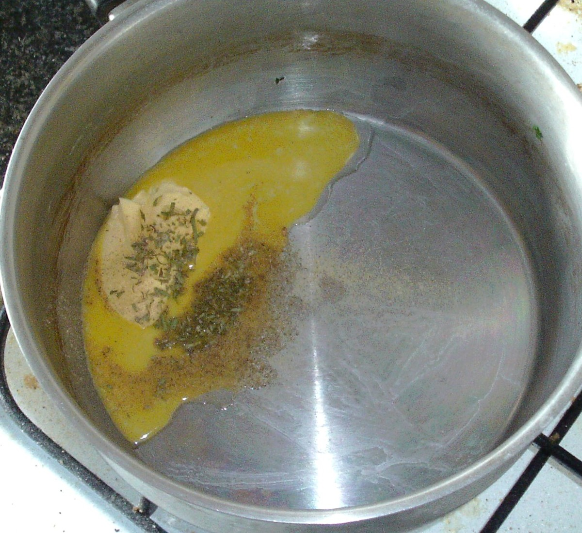 Butter is melted with turmeric, tarragon and seasonings