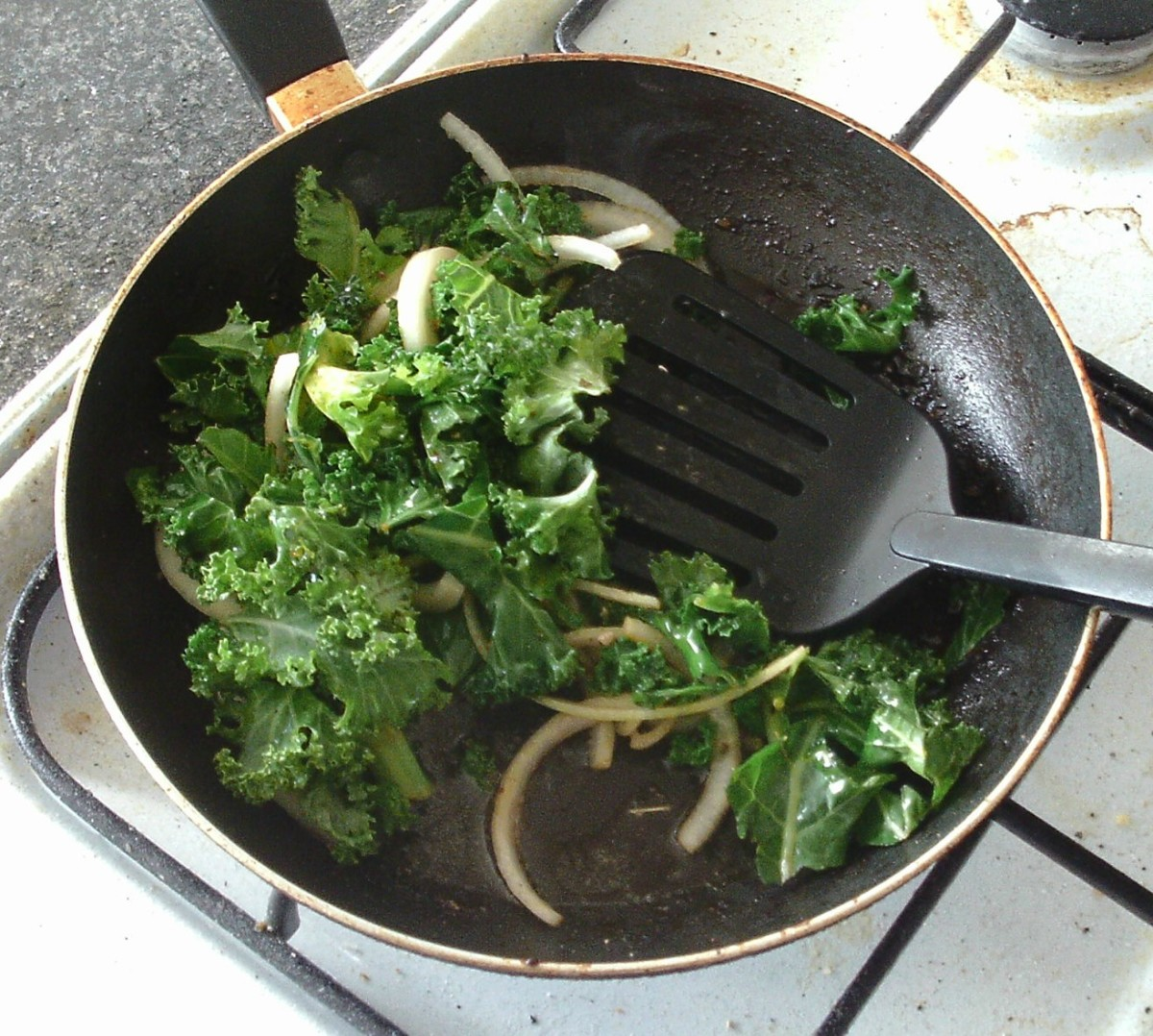 Kale and onion are gently sauteed in pork fat and juices