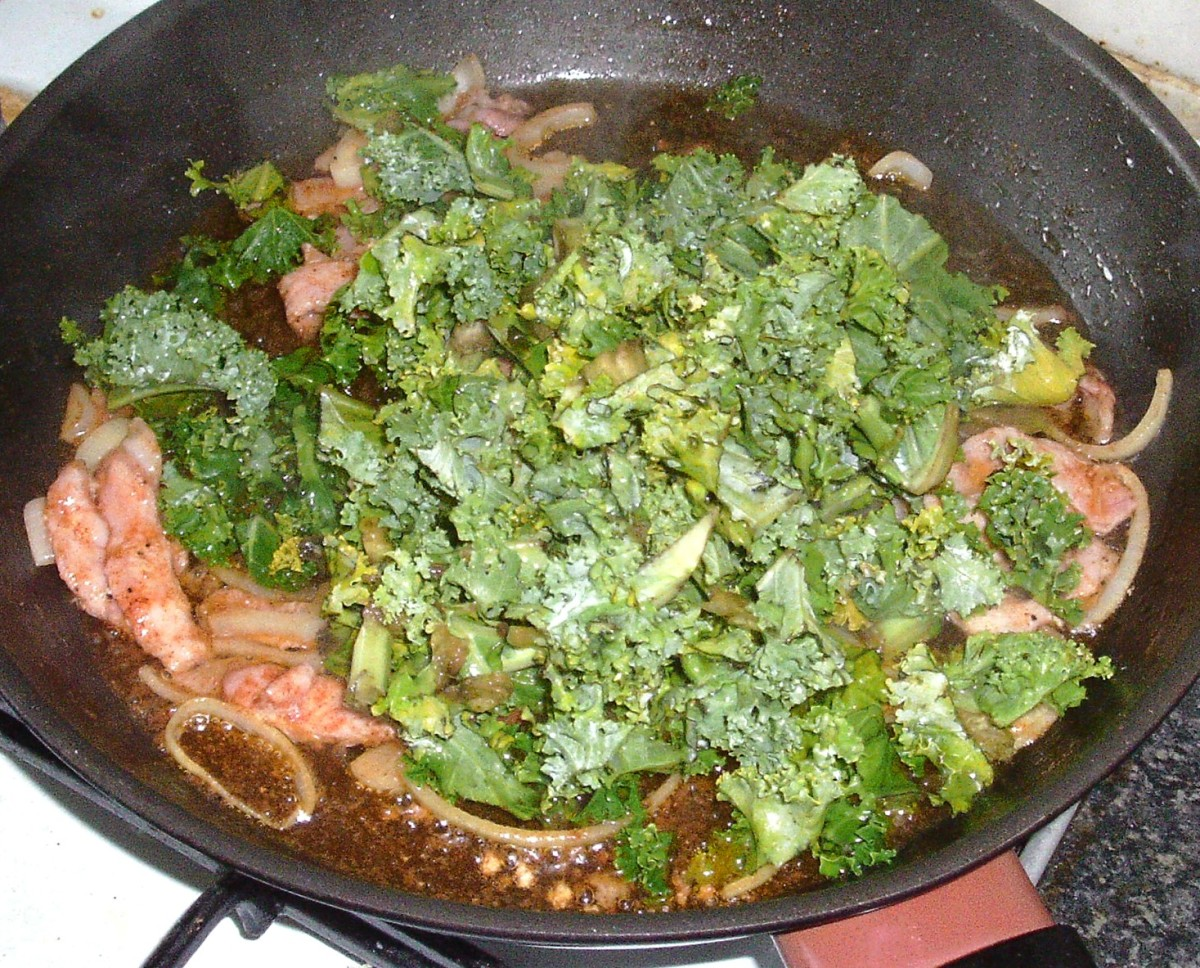 Kale is added to sauteed bacon and onion