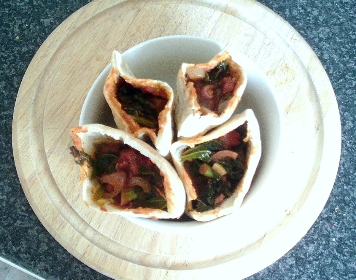Curried kale is served in halved pitta bread cups