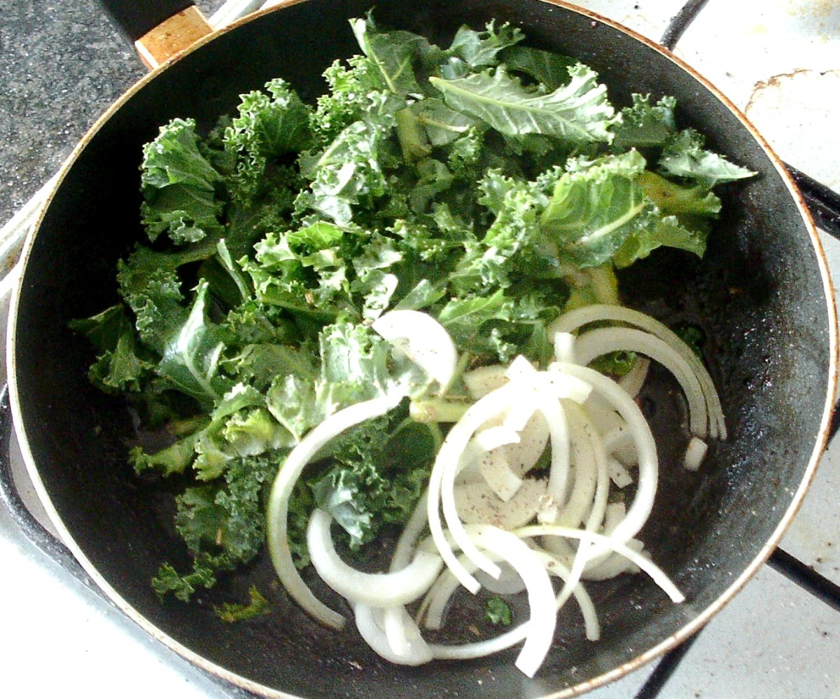 Kale and onion are added to the pan of pork juices and seasoned