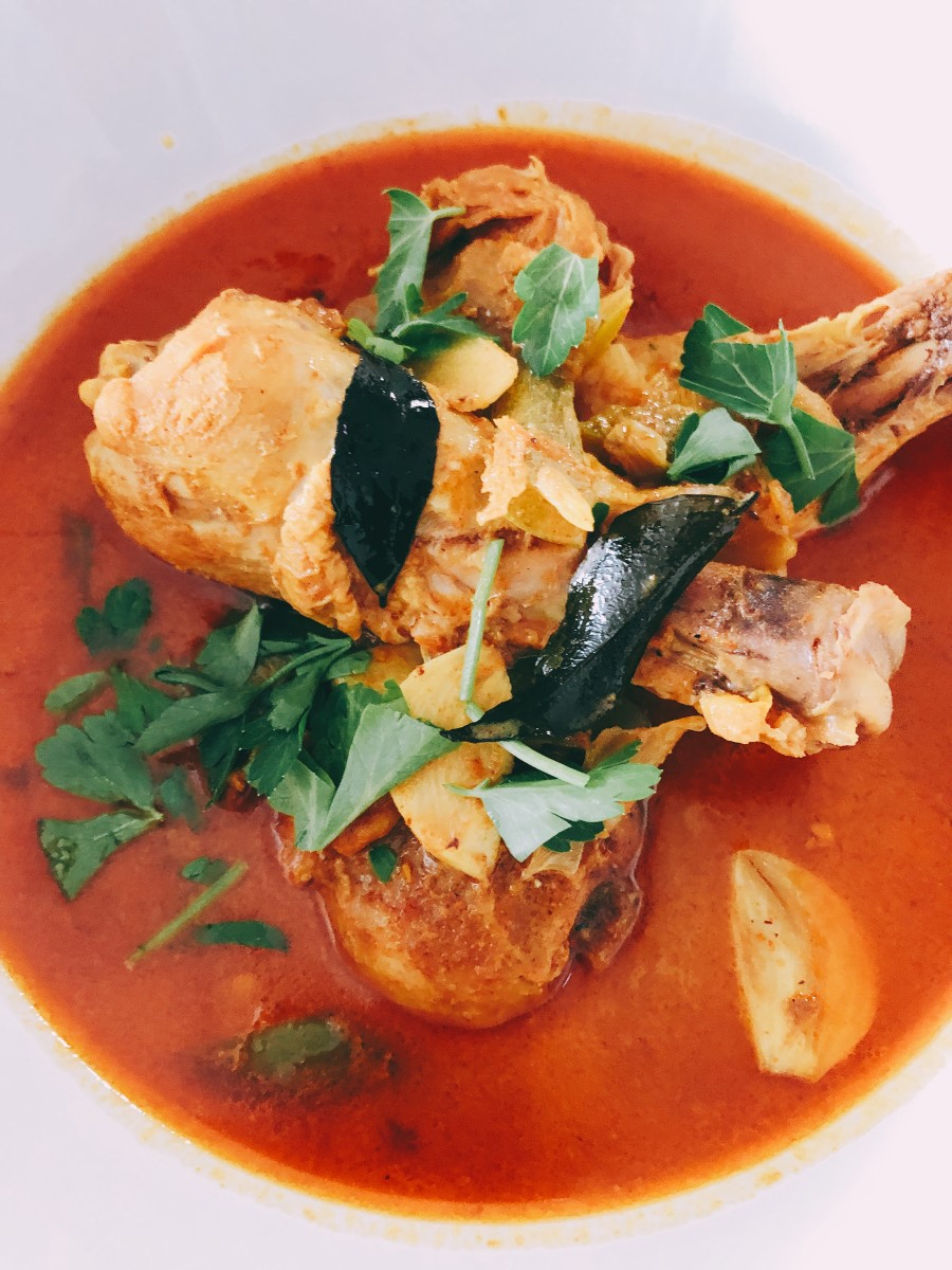 One of my favorite dishes to make at home is Malay-style chicken curry. The main ingredients are coconut milk, curry powder, curry leaves, chicken, and assorted spices.