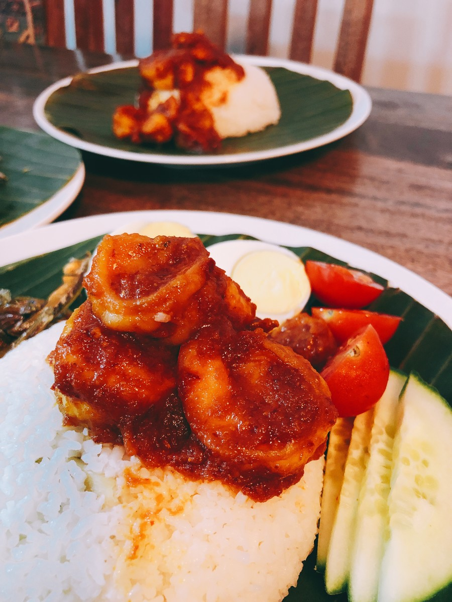 Nasi lemak, or fragrant coconut rice, is known for the aromatic smell of fresh, green pandan leaves and the light flavor of sweet and creamy coconut milk. Pandan leaves are commonly used for coloring and flavoring in Southeast Asian cuisine.