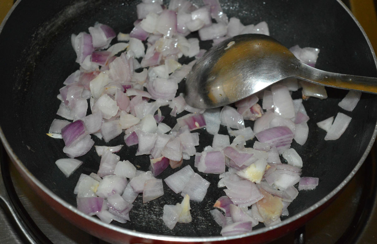 Step 3: Heat the remaining oil in a deep-bottomed pan. Add chopped onions. Saute until they turn pinkish.