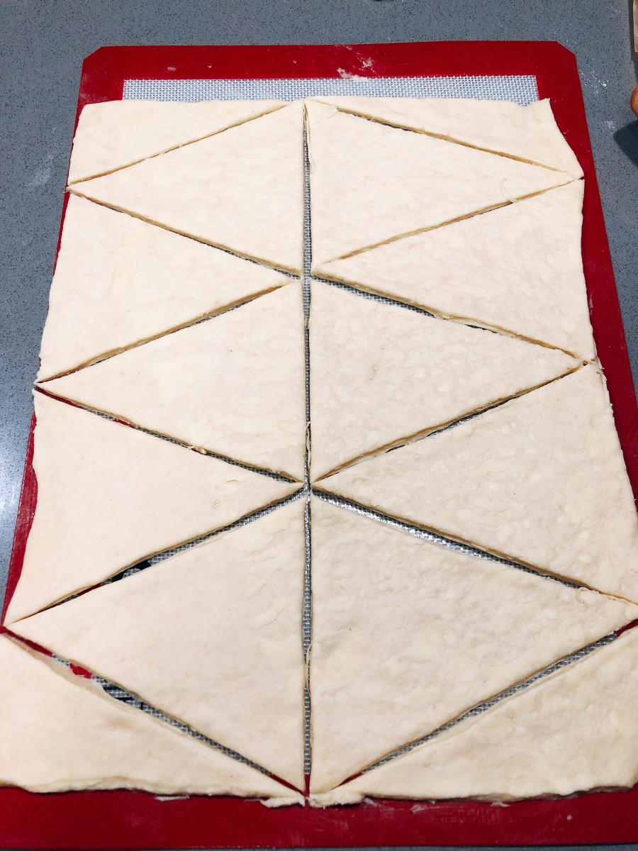 Cut the dough into triangles.