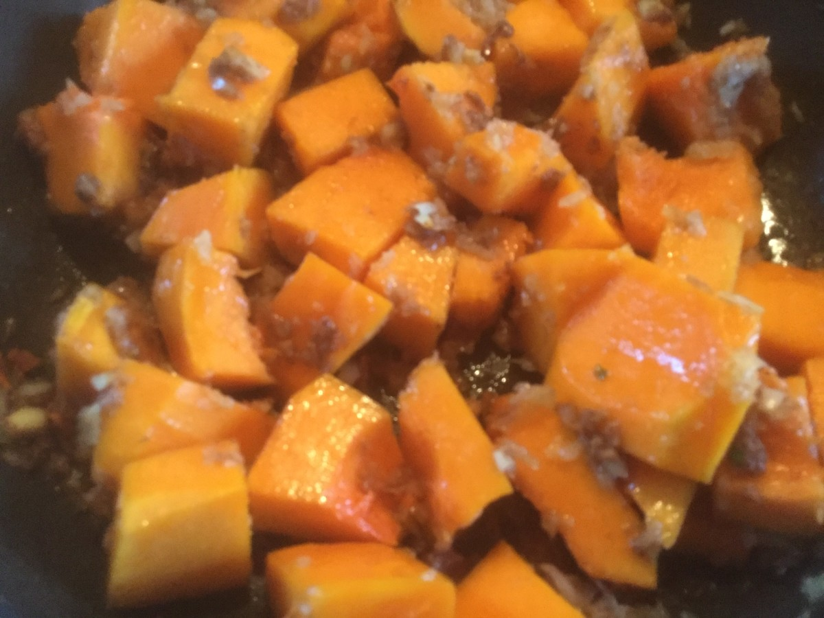 Stir well to coat all of the cubes of squash with spices