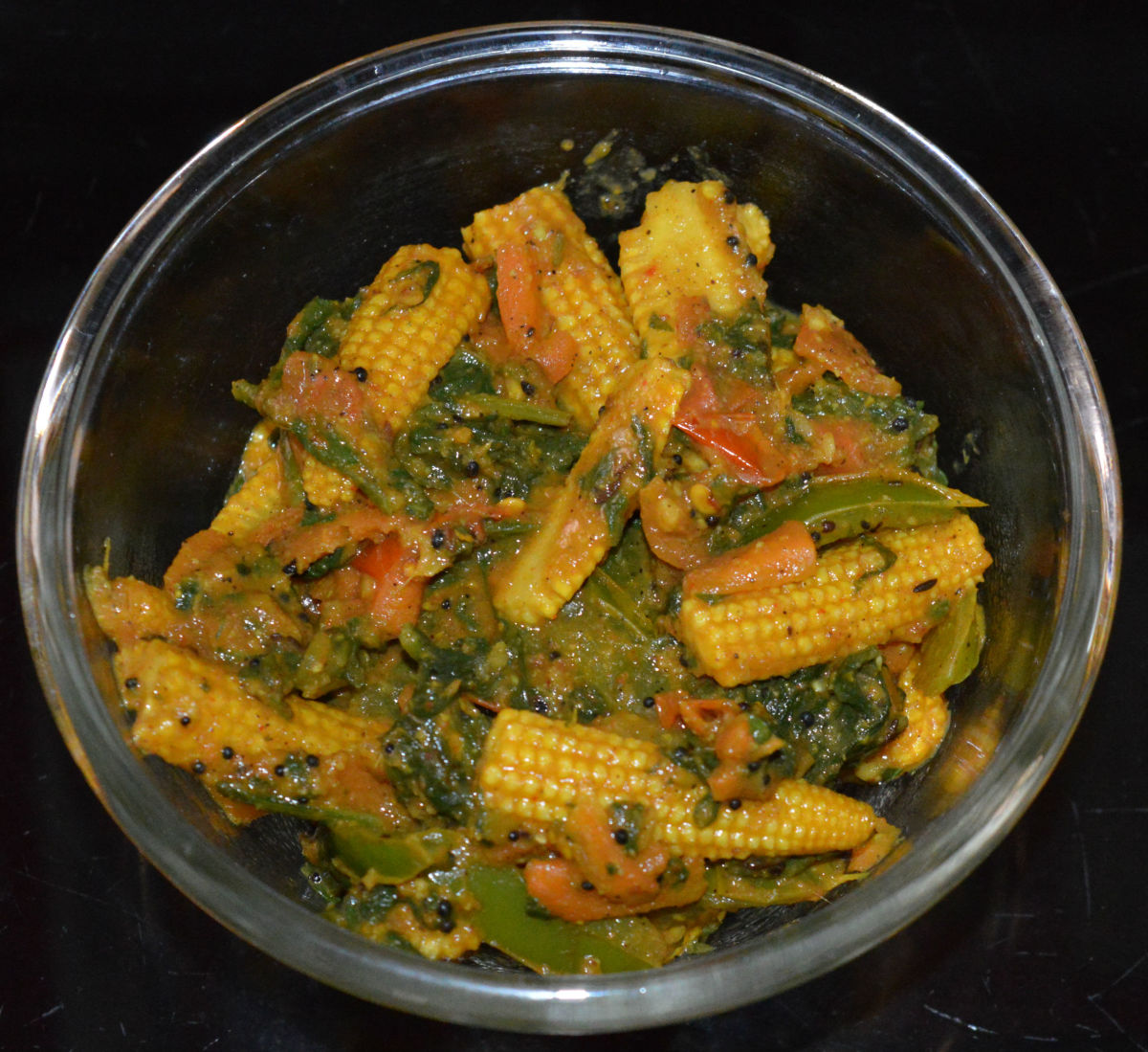 Now, your favorite baby corn and spinach easy curry is ready! Serve it with steamed rice, fried rice, or flatbreads. Enjoy the combo!
