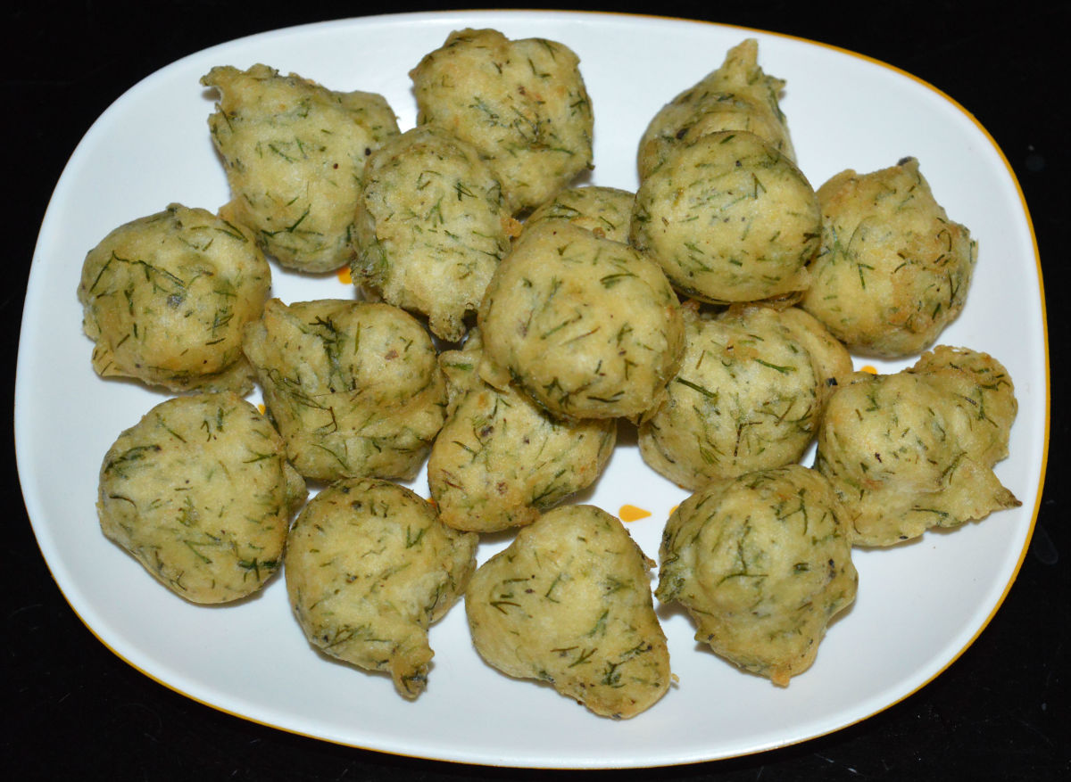 Serve hot with coconut chutney, green chutney, or tomato sauce. Enjoy eating the smoky-flavored fritters!