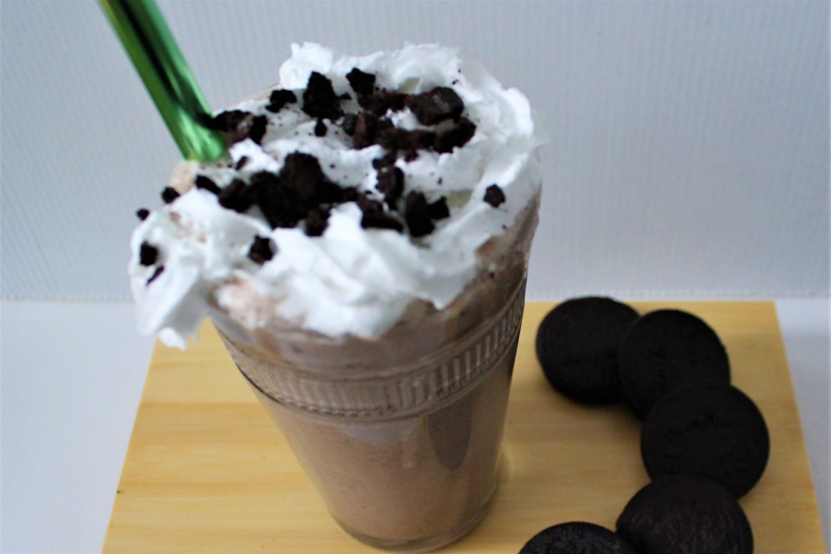 Vegan Oreo Milkshake with vegan whipped cream, topped with cookie crumble.