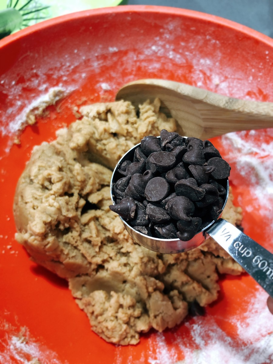 Add the chocolate chips into the mixture. Use a spatula to incorporate the ingredients.