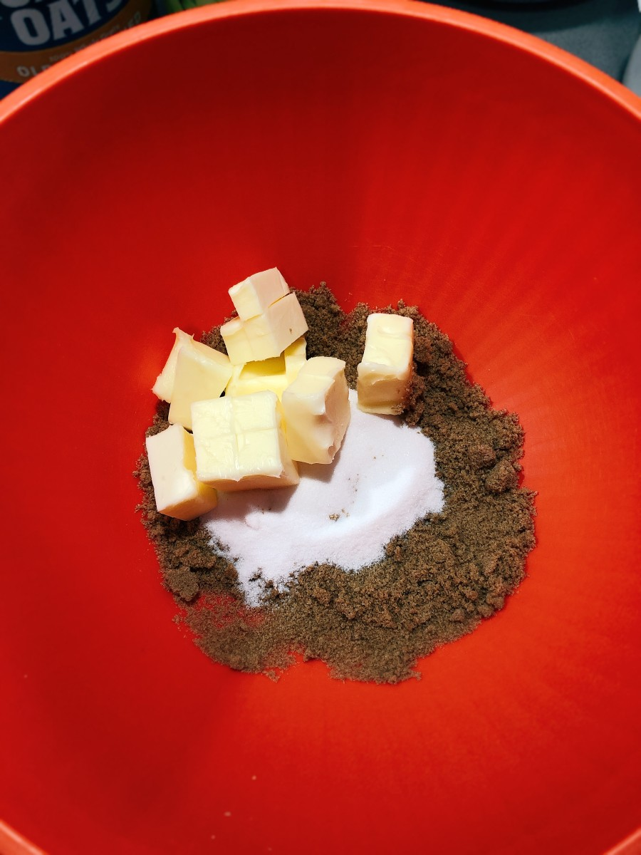 In a mixing bowl, combine the sugar, butter, dark brown sugar, vanilla, and egg.