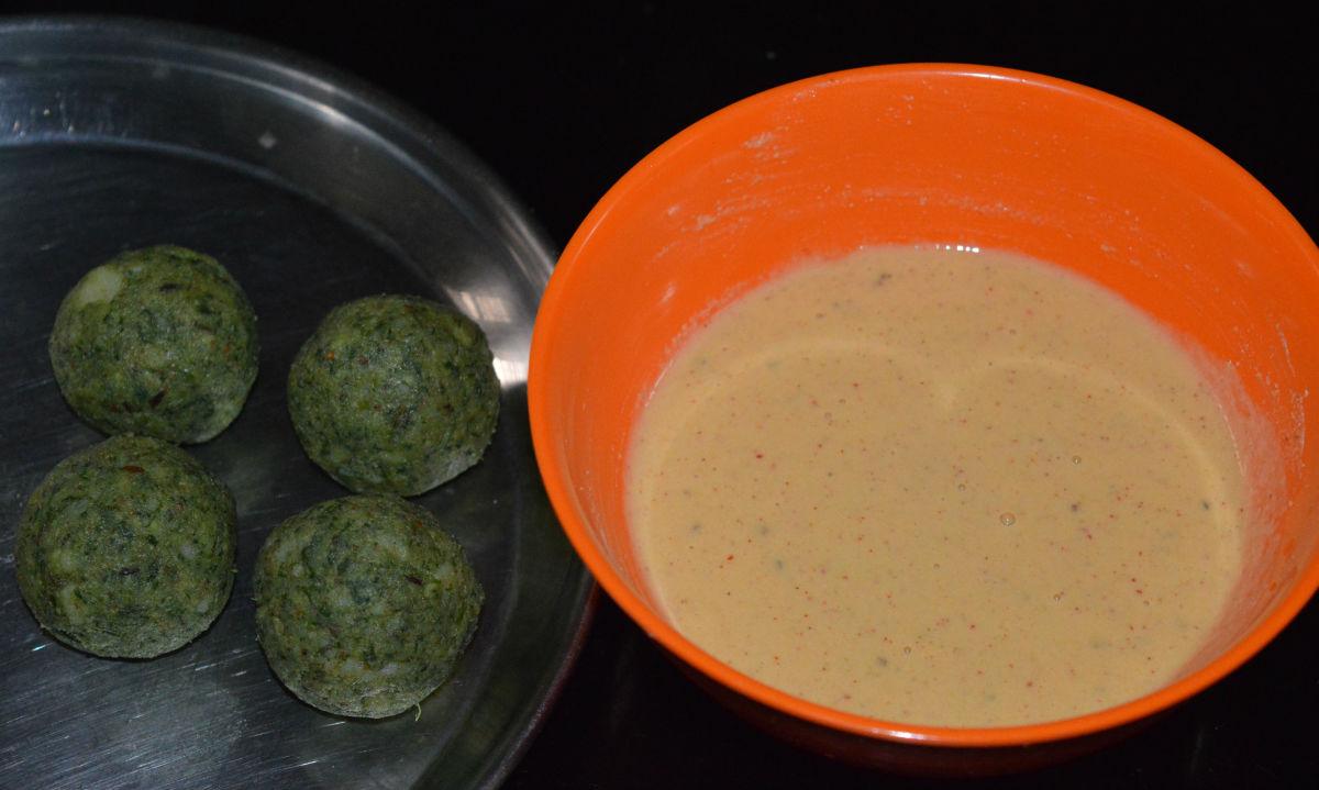 Divide the dough into many lemon-sized portions. Shape them into balls. Set the balls on a plate alongside the batter.