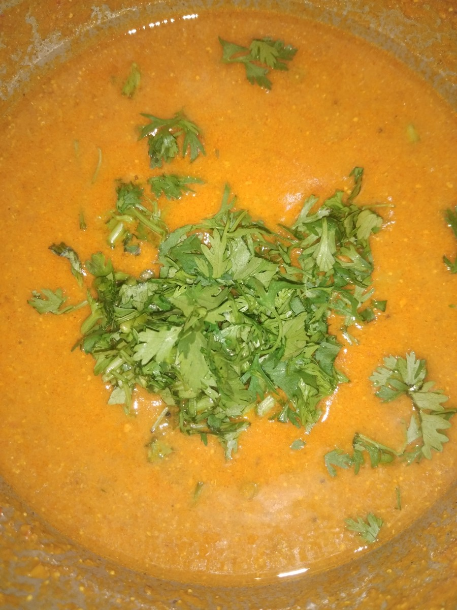 Once it has cooled, open the lid. Garnish with finely chopped fresh coriander leaves.