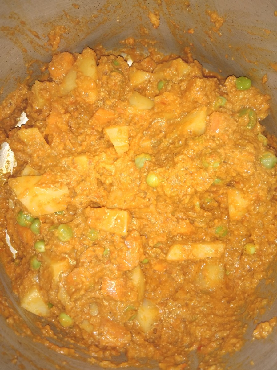 Now add chopped potato, carrot, and peas. Saute and mix on medium to low flame.