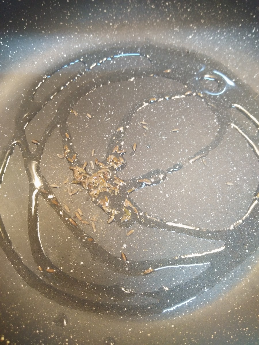 In a pan, heat oil. Add cumin seeds and allow them to splutter.