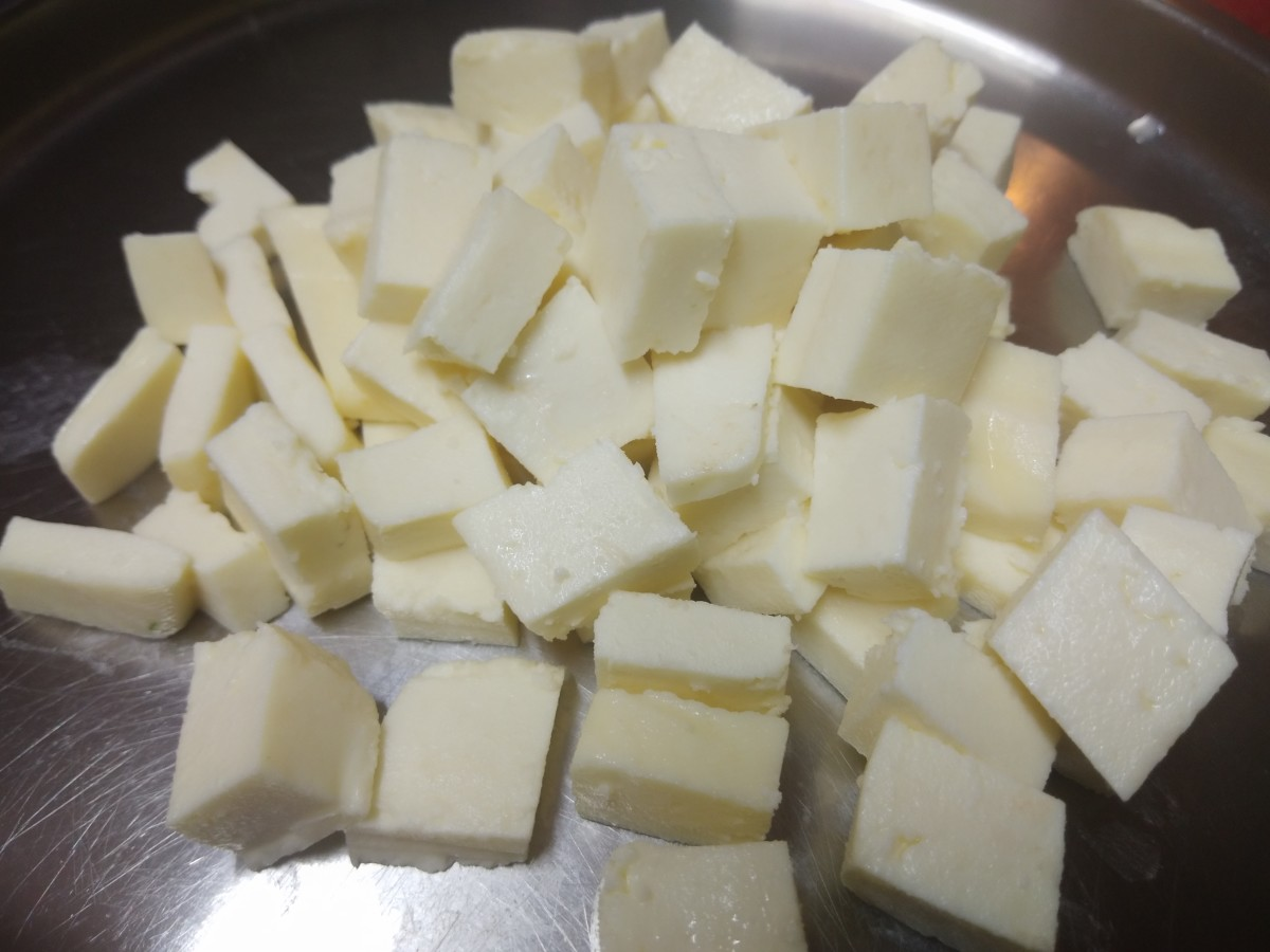 Cut paneer into equal-sized cubes. Set aside.
