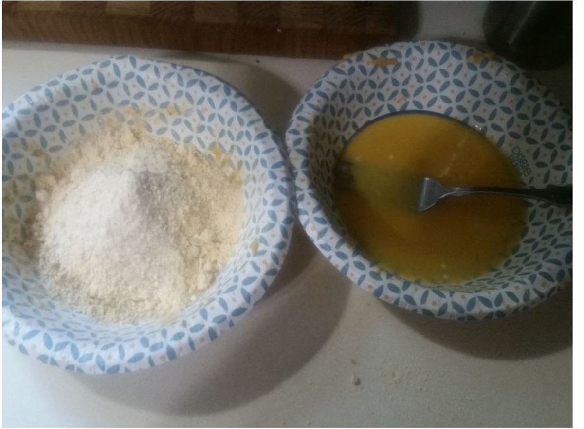 Left: Fryin' Magic powder for coating. Right: Beaten eggs for coating.