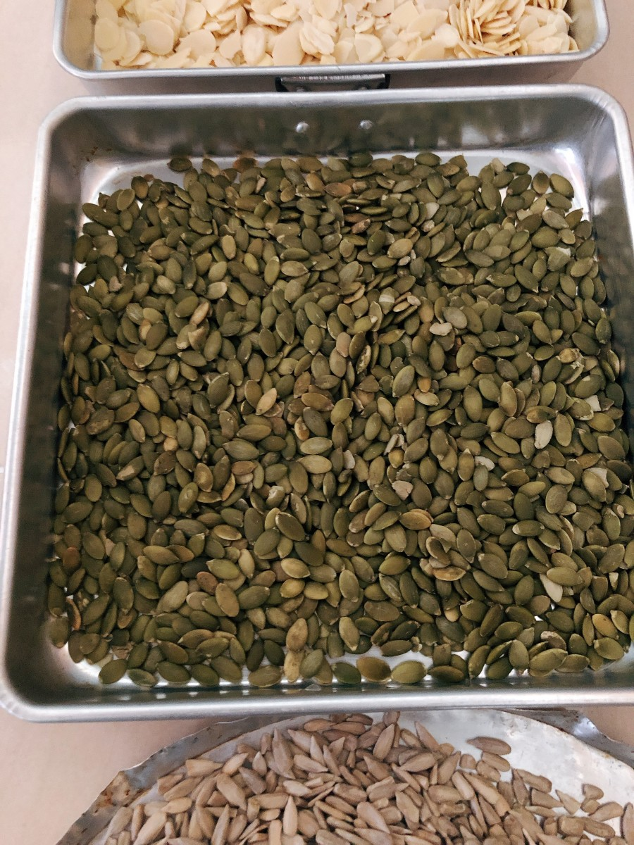 Dump the pumpkin seeds on a tray and bake for 5 minutes in the oven.