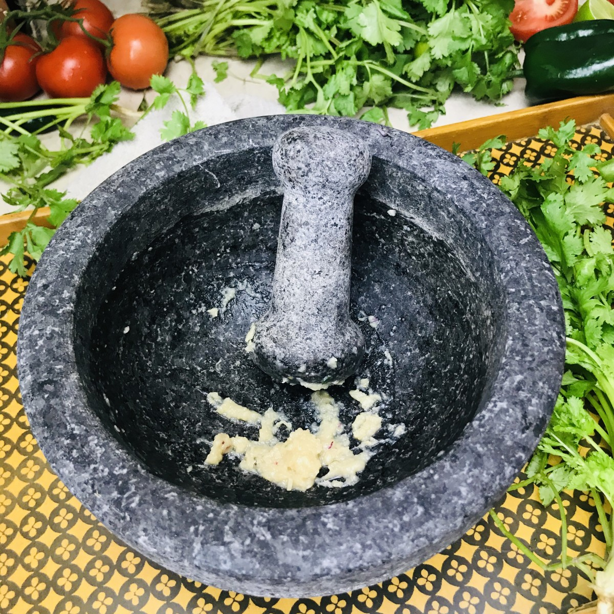 Mash the garlic in a molcajete until it is creamy with very few lumps.
